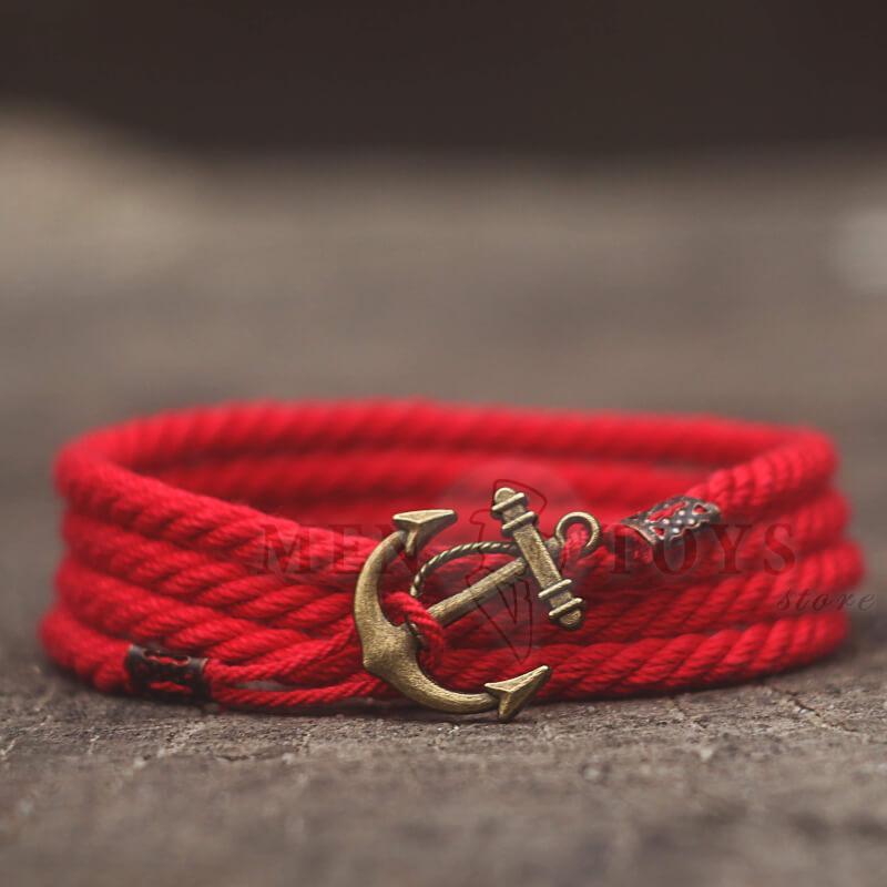 красный браслет с якорем